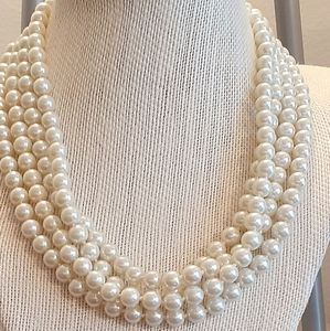 Extremely long pearl necklace